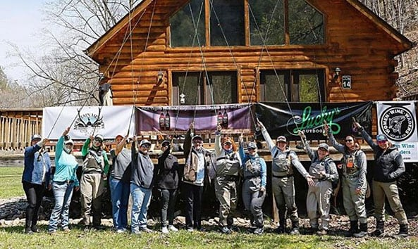 group of anglers in front of a cabin at Harman's
