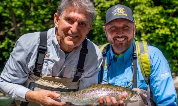 senator joe manchin holding a trout